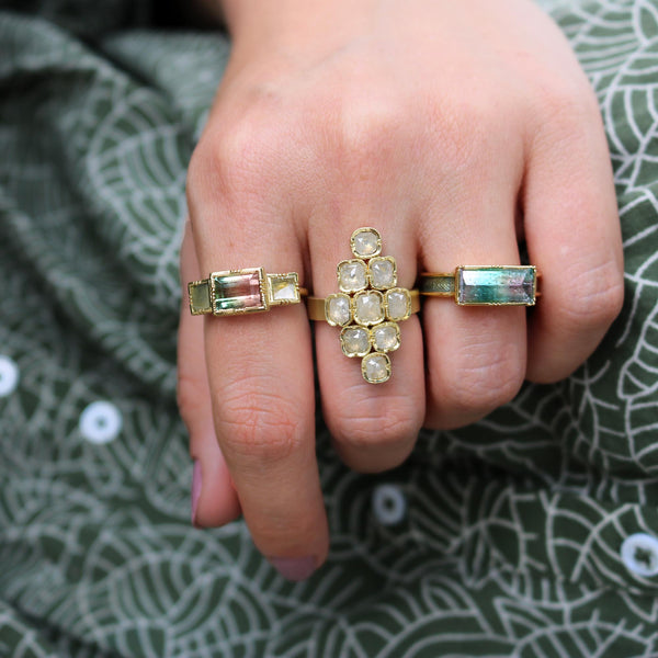 Model wearing Hand made in London Brooke Gregson 18k gold enamel band rainbow tourmaline ring