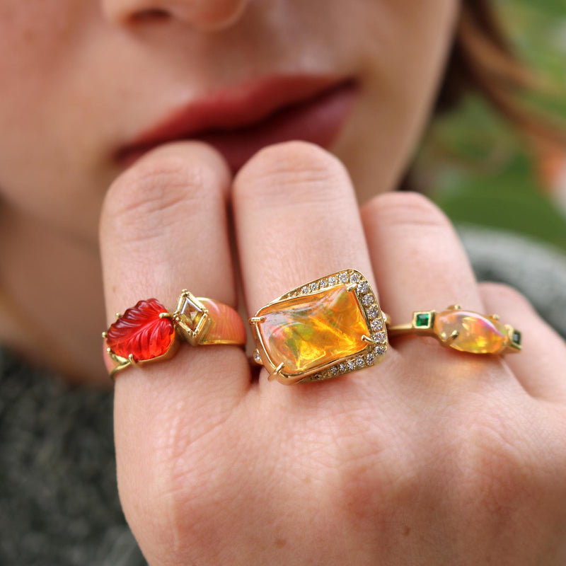 Model wearing Hand made in London Brooke Gregson 18k gold Diamond Carved Fire Opal Leaf Ring