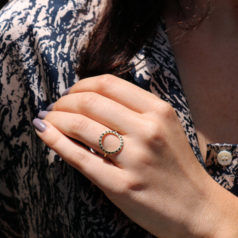 Model wearing Hand made in Los Angeles Brooke Gregson 14k gold black diamond Circle ring