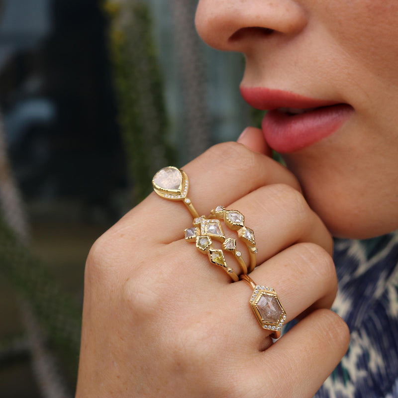 Model wearing Hand made in London Brooke Gregson 18k Gold Diamond Wedding Ring