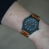 The Olsmsted Matte watch with a leather band