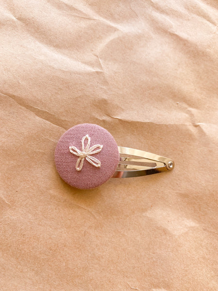 One Embroidered flower snap clip