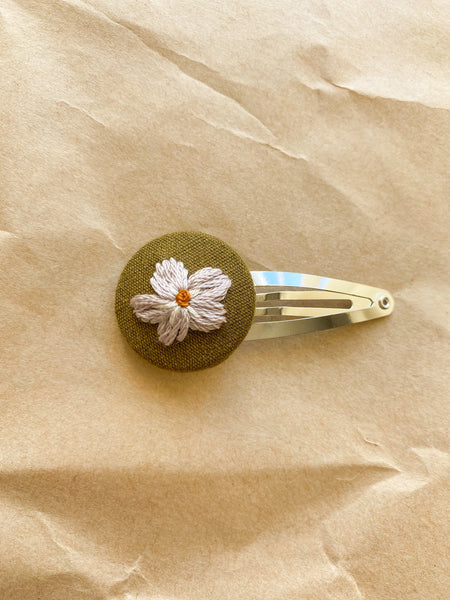 Detailed flower embroidered snap clip