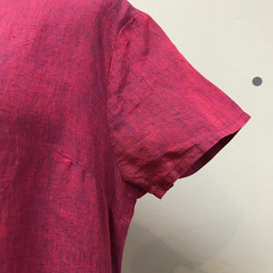 Sleeve detail of Elemente Clemente raspberry colored linen dress