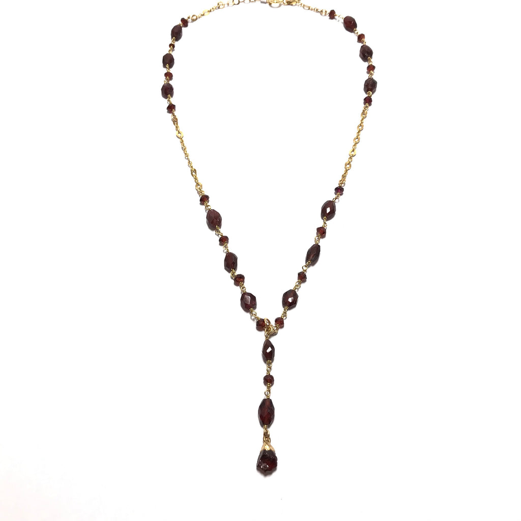 Athena Y shaped necklace with garnet oval beads on a gold-filled chain with the length of 16""