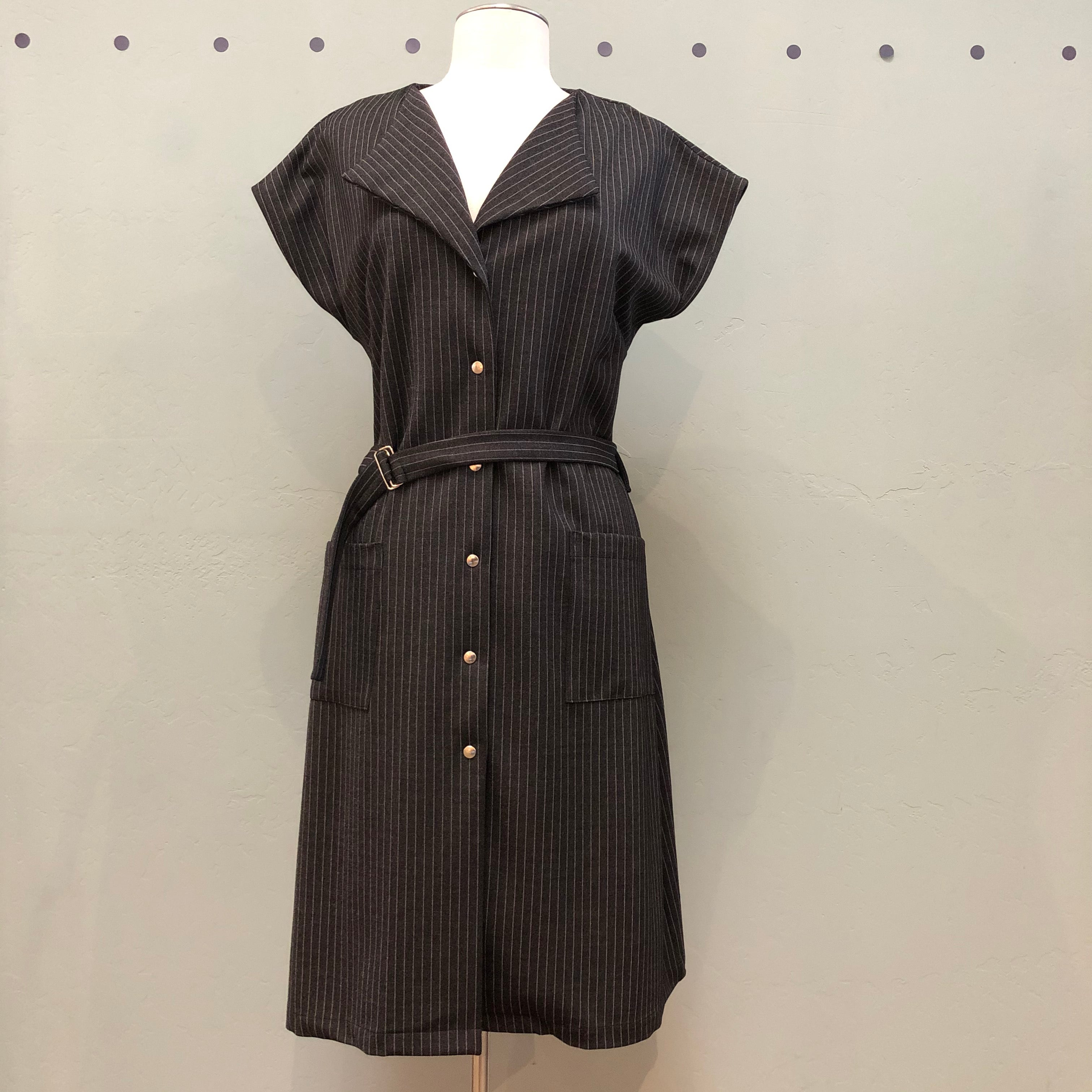 Marigold shirt waist dress with wing collar, short sleeves, belt and patch pockets in a black with white stripe