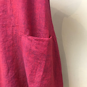 Front deep pocket detail of Elemente Clemente raspberry linen dress.