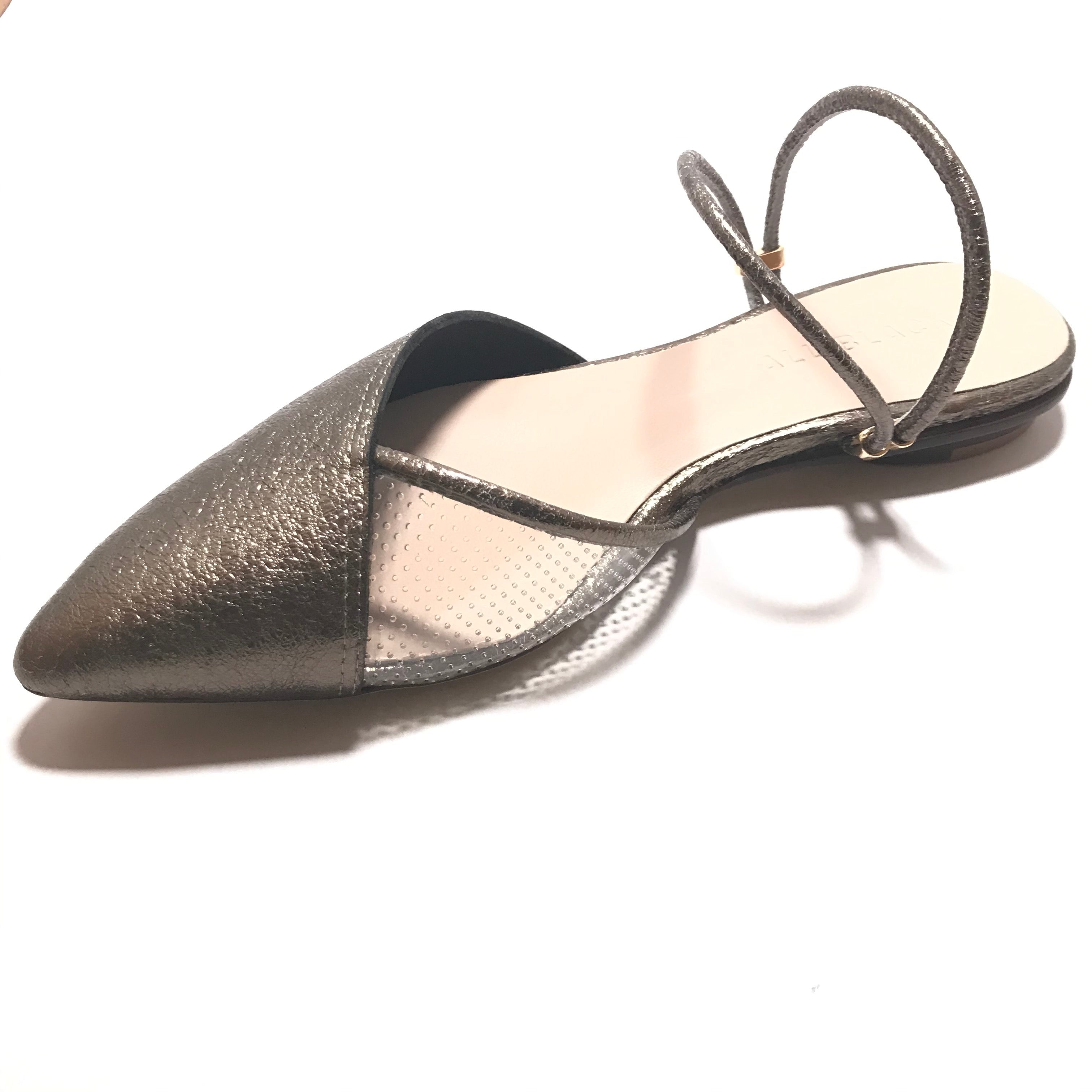 "Side view of All Black pointed toe shoes with a heel of 1/4"" height with a double elastic ankle strap in the color of silver"