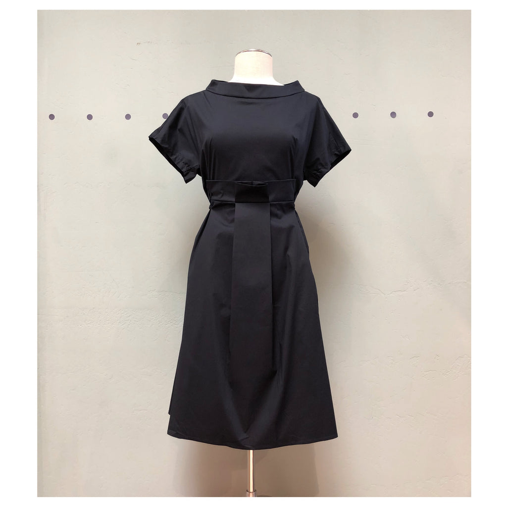 Black dress with a mock neckline, tie waist,  pleated front detail, short sleeve, knee length, cotton and elastane