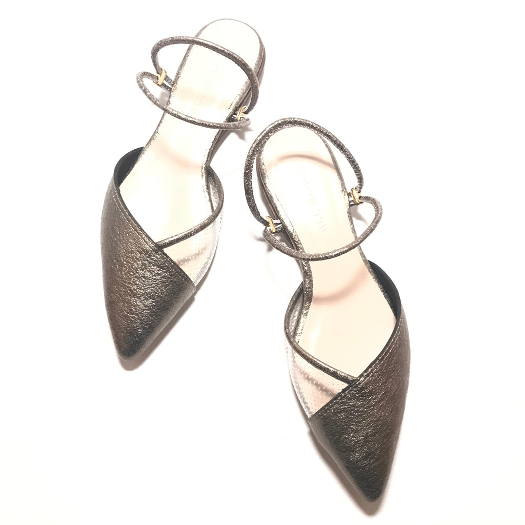 "All Black pointed toe shoes with a heel of 1/4"" height with a double elastic ankle strap in the color of silver"