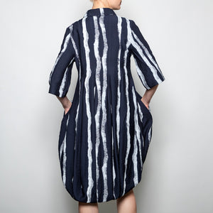 Button down 3/4 sleeve coat/dress in navy abstract stripe back view