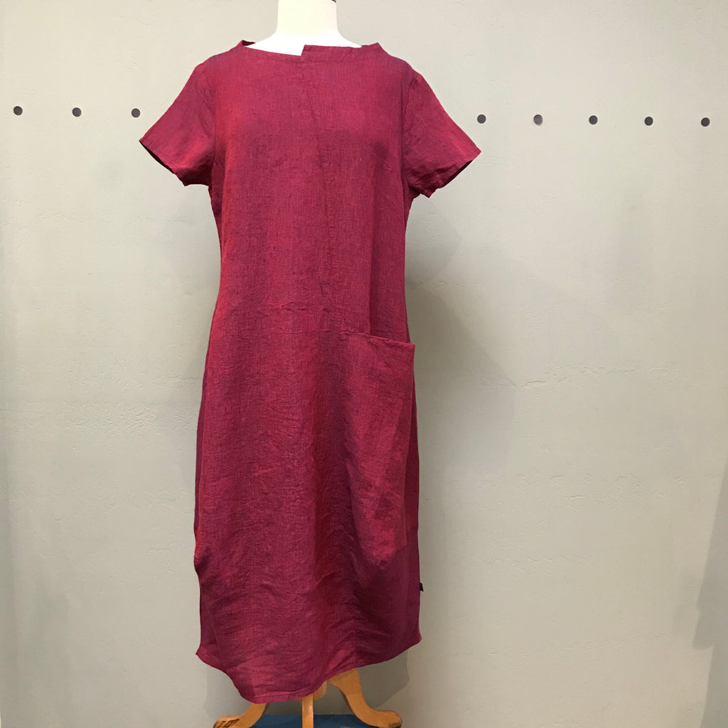 Elemente Clemente raspberry color linen dress with short sleeves and asymmetrical neckline.  Full bodied with asymmetrical seam detail, front left deep pocket and right side seam pocket.