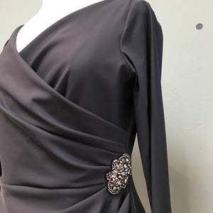Detail of Cocktail dress draped with jewel in charcoal