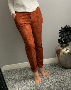 "Rust snake print ""magic"" trousers"