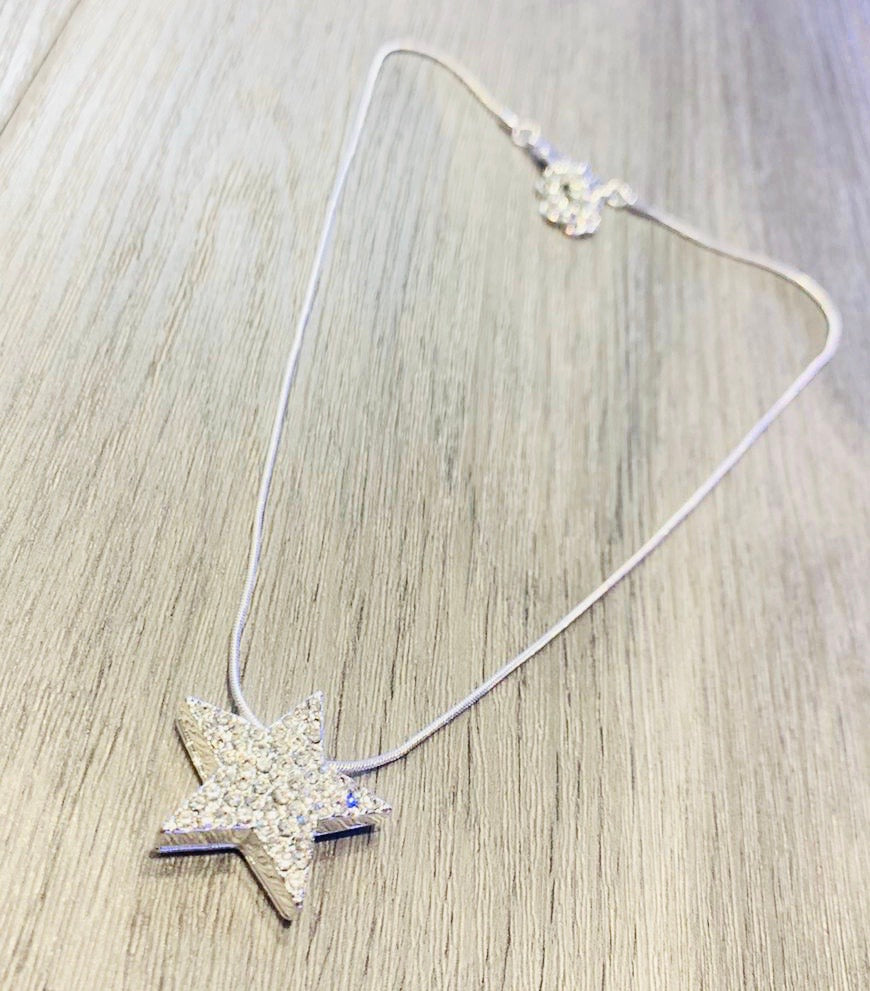 Rhinestone star pendant on a short thin snake chain