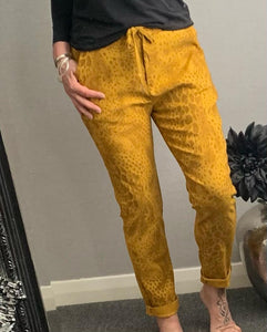 "Mustard snake print ""magic"" trousers"