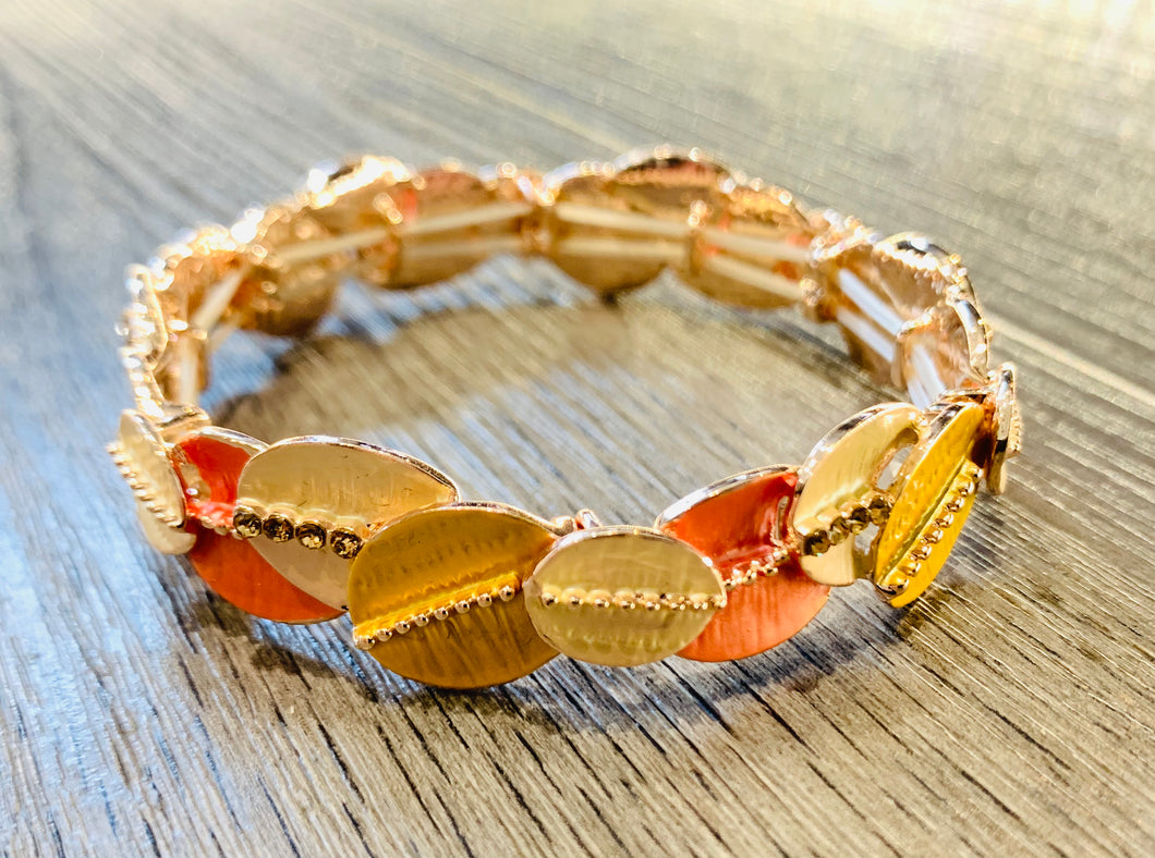 Orange tone elasticated bracelet with rhinestone detail