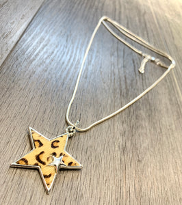 Beige animal print star pendant on a long snake chain