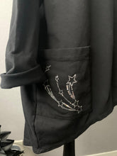 Load image into Gallery viewer, Oversized black top with shoulder and pocket star detail