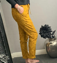 "Load image into Gallery viewer, Mustard snake print ""magic"" trousers"