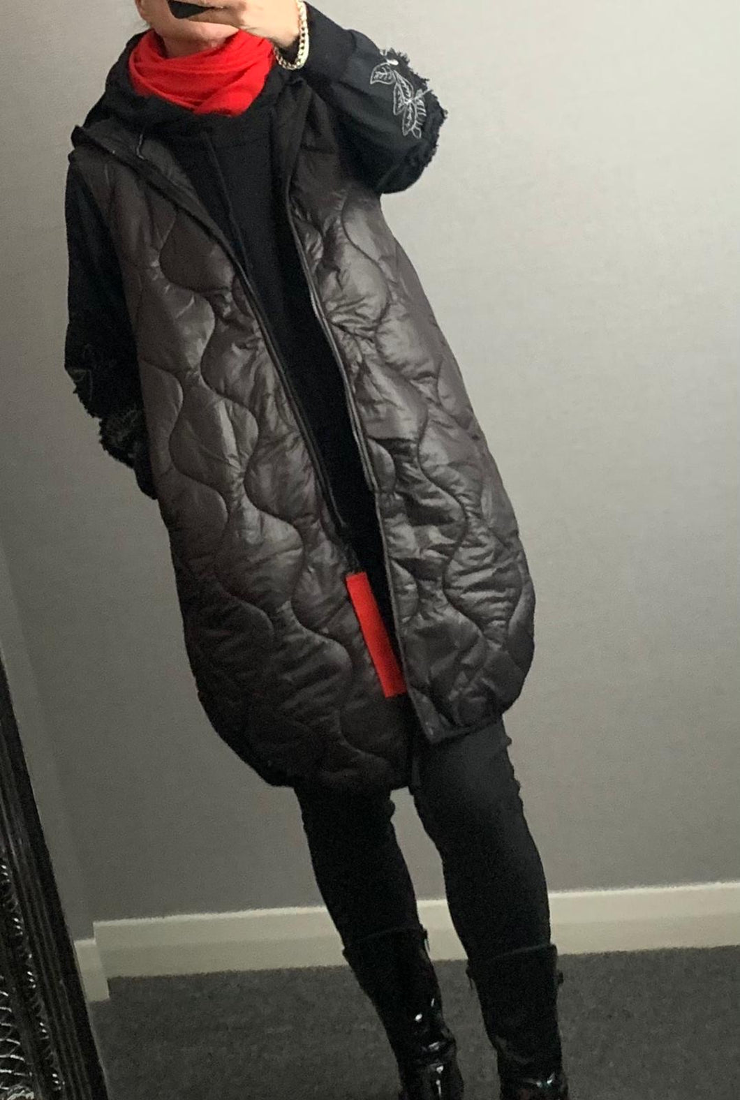 Black quilted bodywarmer with hood and pockets