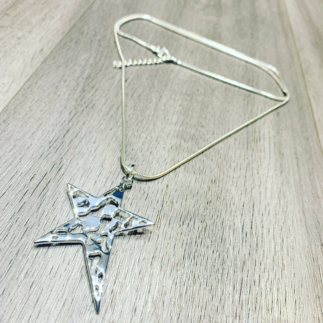 Abstract star pendant on a long snake chain