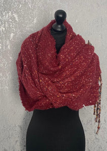 Red fluffy scarf with multicoloured tassels