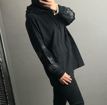 Load image into Gallery viewer, Black oversized hoodie with appliqué detailed sleeve and silver threads