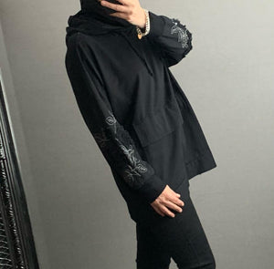 Black oversized hoodie with appliqué detailed sleeve and silver threads