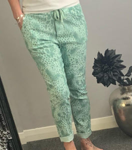 "Green snake print ""magic"" trousers"