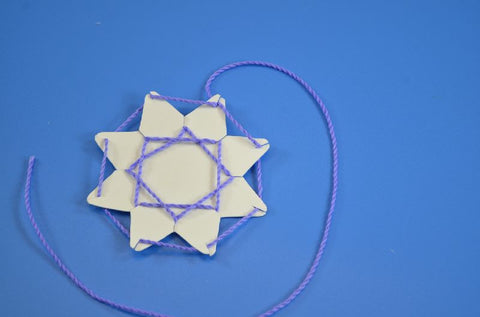 Image of Roylco R16024 Stringing Shapes Star example of artwork blue star