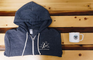 One blue cozy hoodie with a camper mug with the Wild Goose logo on the mug