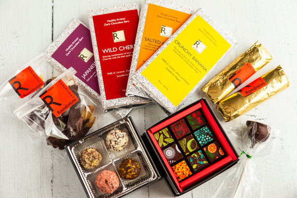 Gourmet Chocolate Bundle, with a selection of delicate chocolate art bonbons and dark chocolate truffles, four handcrafted dark chocolate bars, and mystery gifts for an indulgent chocolate experience. All made with 70% Venezuela Cocoa.