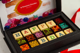 18 gourmet dark chocolate art bonbons and the words Happy BDay. Handcrafted with 70% Venezuela Cocoa to ensure an exquisite chocolate experience in every bite.