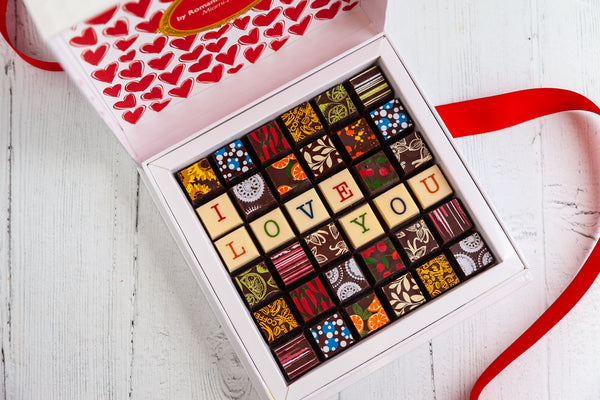 36 exquisite gourmet Dark and White Chocolate Art Bonbons and the words I Love You with a custom message. Handcrafted with 70% Venezuela Cocoa. Vegan Chocolates Available. Nationwide Delivery.