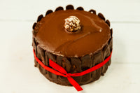 "Triple Dark Chocolate Mousse Cake made with 70% Venezuelan Cocoa. Our Dark Chocolate Cake can be ordered in 6"" and 9"" diameter, and it's gluten-free. Only available in the Miami Area. A perfect centerpiece for your celebrations."