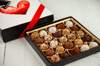 25 or 50 dark chocolate Truffles and a beautiful I Love You Art Cover. Handcrafted with 70% Venezuelan Cocoa. Choose between our single layer, double layer, or mixed layer with our chocolate art bonbons. Nationwide Delivery.