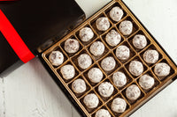 8, 16, or 25 dark chocolate truffles made with a crunchy dulce de leche treasure at the center hidden by a layer of the finest dark chocolate and lightened with a sugar glacé. Nationwide Delivery.