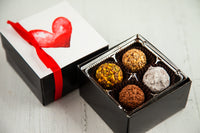 8 dark chocolate truffles of assorted flavors and a beautiful love art cover. Handcrafted with 70% Venezuelan Cocoa. Nationwide Delivery.