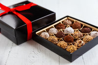 16 or 32 dark chocolate truffles of assorted flavors, handcrafted with Venezuelan Cocoa, the best of the world. Nationwide Delivery.