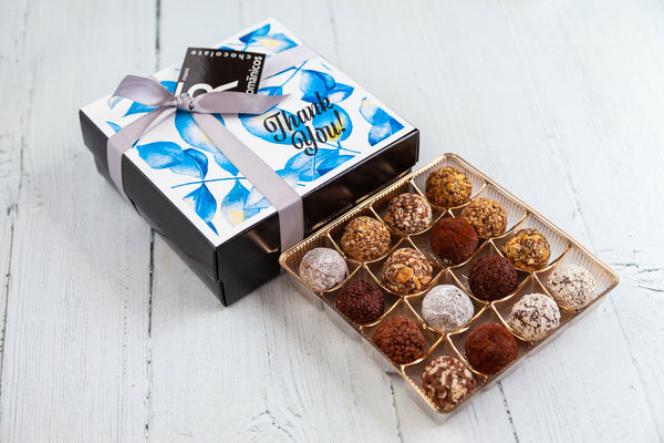 16 dark chocolate Truffles and a beautiful Thank you Box Cover. Handcrafted with 70% Venezuelan Cocoa. Choose between our single layer, double layer, or mixed layer with our chocolate art bonbons.