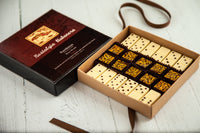 Nostalgia Habanera Special Collections comes with 12 handcrafted dark and white chocolate domino shaped bonbons with guava and cheese filling and 10 fine Espresso Bean Dark Chocolate Art bonbons. Un chocolate exquisito inspired in the Cuban Miami Flavors and delivered nationwide.