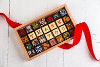 Thank You Chocolate Art Limited Edition Wooden Box. 28 gourmet dark chocolate art bonbons and the words Thank You. Great as a corporate gift for your clients. Handcrafted with 70% Venezuelan Cocoa.