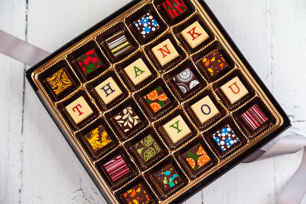 King Size Thank You Chocolate Box. 25 gourmet dark chocolate art bonbons and the words Thank You. Handcrafted with 70% Venezuelan Cocoa.