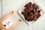 Artisanal Wild Cherry Dark Chocolate Crunchy Bytes, handcrafted with tangy cherry bits and 70% Venezuelan Cocoa, suitable for vegans, dairy and gluten-free. 140 gr full of flavor.