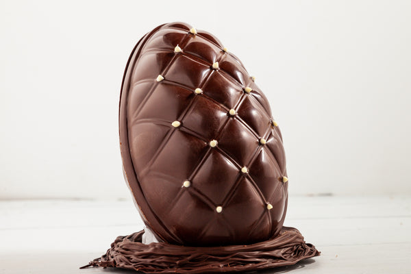 Large Gourmet Chocolate Easter Egg. Filled with 5 mini chocolate easter eggs, white chocolate chips, mini marshmallows and white, milk and dark chocolate confetti. It comes with its nest made of solid dark chocolate.