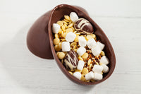 Medium Gourmet Easter Egg made of Dark Chocolate and filled with 3 mini Easter Eggs, White Chocolate Chips, Mini Marshmallows and White, Milk and Dark Chocolate Confetti. It comes with a nest made of solid dark chocolate.