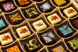 25 or 50 gourmet dark chocolate art bonbons with a 5 beautiful Thanksgiving motif imprinted in White Chocolate and Dark Solid Chocolate Bonbons. Handcrafted with 70% Venezuelan Cocoa. Choose between our single layer, double layer, or mixed layer with our signature truffles. Nationwide Delivery.