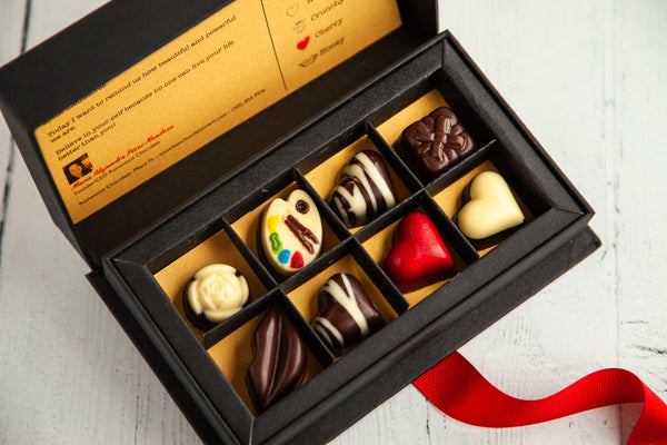 Our Woman's Box comes with 8 gourmet chocolate jewels made of dark and white chocolate and assorted fillings such as Nutella, Salty Caramel, Berries, Champagne, Cherry, Honey, or Crunchy Nutella. With uplifting messages of empowerment, it is the perfect gift for the women in your life.
