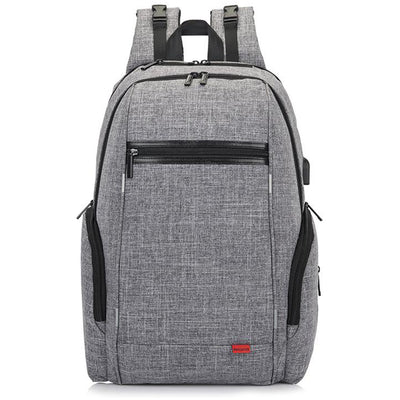 Diaper bag for dad or mom with built in stroller straps, 4 insulated bottle pockets, external wipes pocket, and a seperate safe padded laptop pocket. daddy diaper bags;  diaper bag backpacks; best diaper bag; modern diaper bag; cool diaper bags for cool dads; diaper bags for families; diaper bag for working parents; diaper bag for twins;